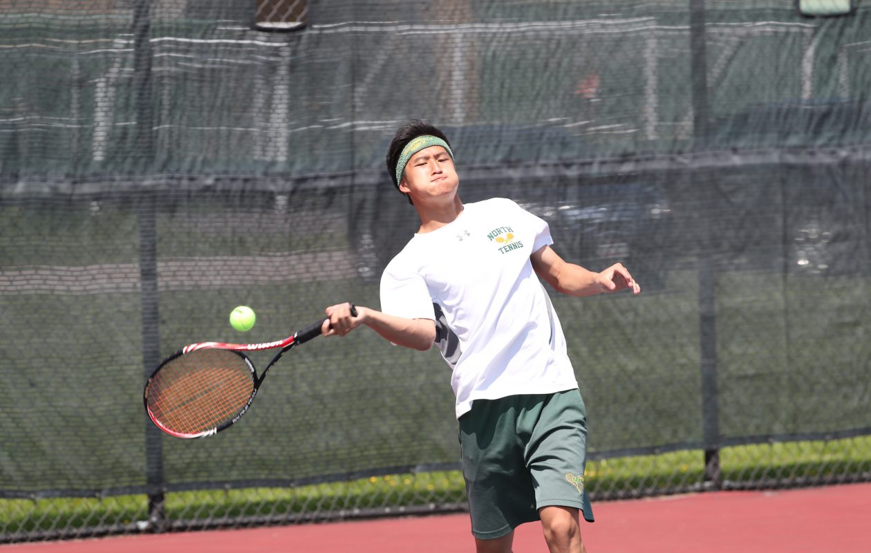Williamsville North's Harry Wang returns a shot en route to the Section VI singles title Tuesday. (James P. McCoy/Buffalo News)