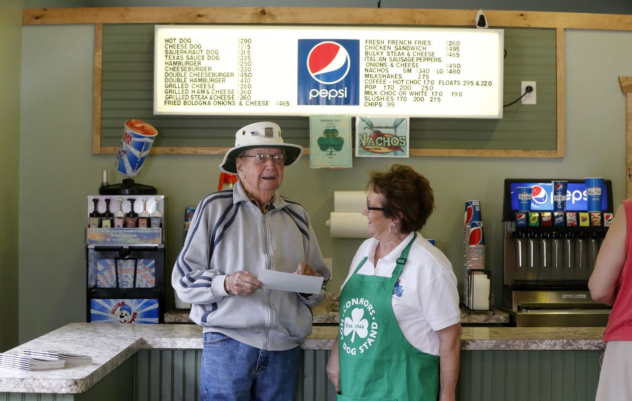 Karen Connors Erickson talks with longtime customer John Moore at Connors Hot Dog stand in Angola Wednesday, May 24, 2017.         (Mark Mulville/Buffalo News)