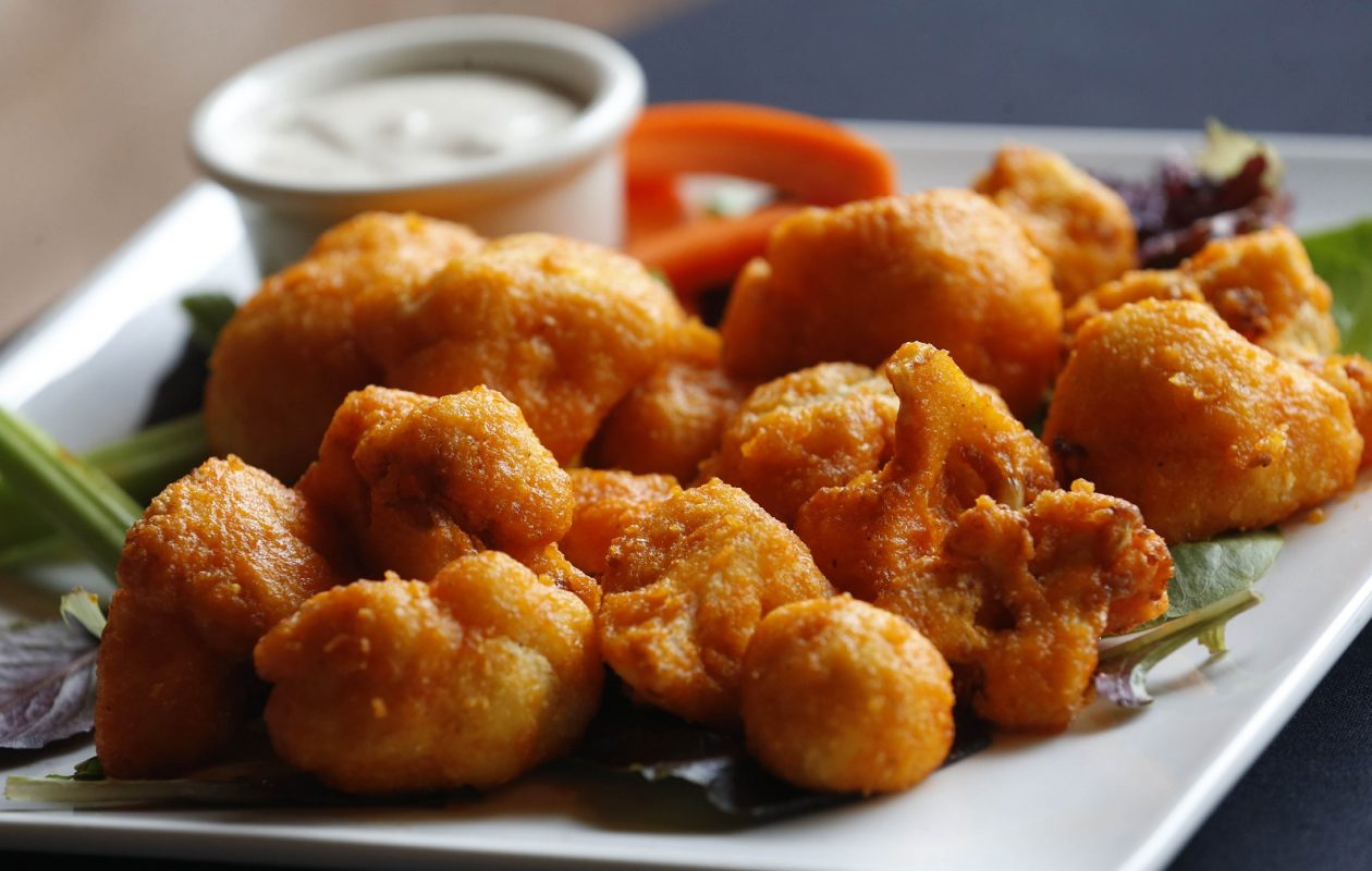 Canal Club 62's Buffalo cauliflower is fried cauliflower in a gluten-free corn breading topped with Buffalo sauce and accompanied by blue cheese. (Sharon Cantillon/Buffalo News)
