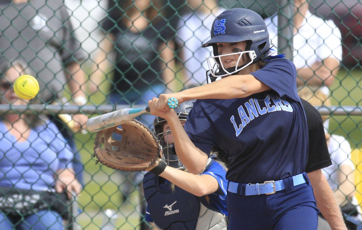 St. Mary's Ava Miller hits a three-run homer in the third inning during the Lancers' victory over Mount Mercy in the Monsignor Martin championship game at Sunshine Park. (Harry Scull Jr./Buffalo News)