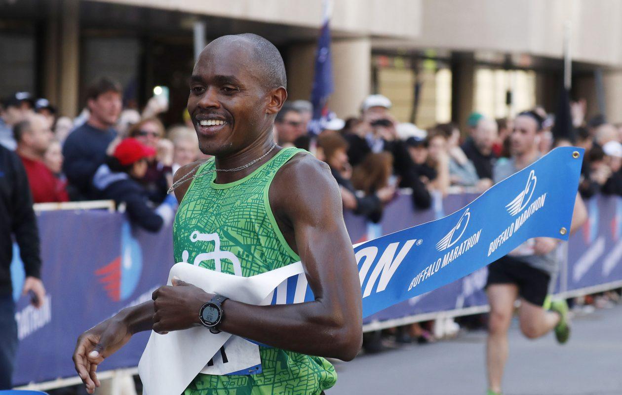 The overall men's winner, Kiplangat Tisia, finishes the Buffalo Marathon on May 28. (Mark Mulville/Buffalo News)