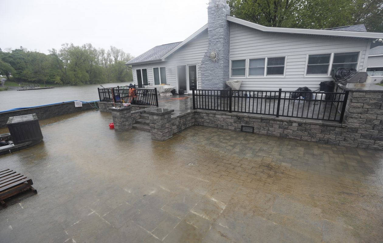Water floods a patio and crawl space at a home/cottage on Twelve Mile Creek in Wilson last May 25.  (John Hickey/Buffalo News)
