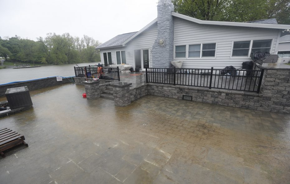 Water floods a patio and crawl space at a home/cottage on Twelve Mile Creek in Wilson in 2017  (John Hickey/Buffalo News)