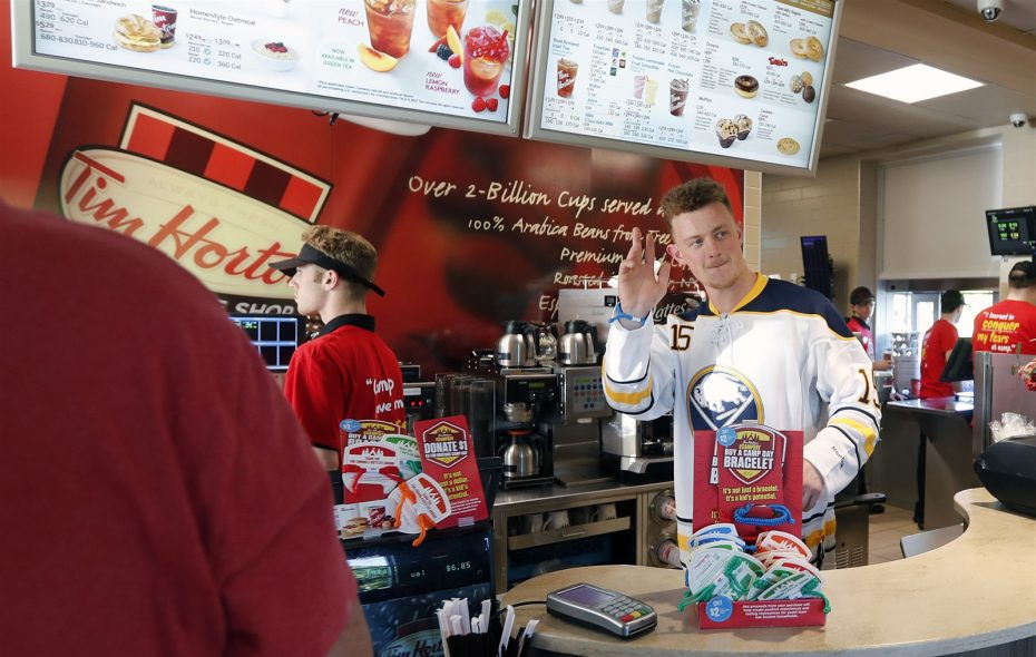 """Jack Eichel helps Tim Hortons celebrate """"Camp Day"""" at the restaurant on Big Tree Road in Orchard Park. (Mark Mulville/Buffalo News)"""