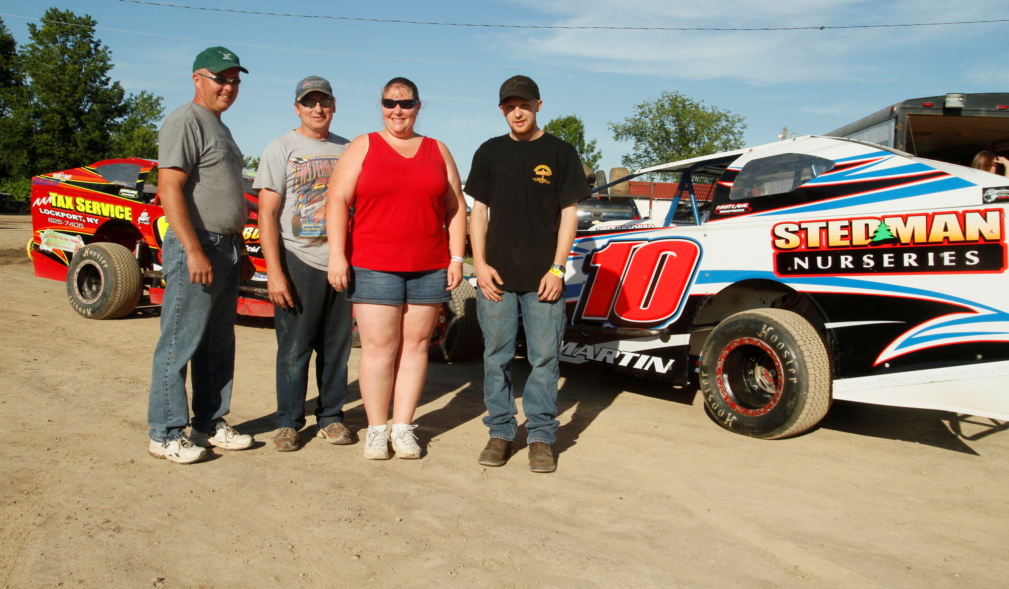 In this 2010 photo at Ransomville, Jennifer Martin is pictured with fellow then-DIRT Sportsman team members (left to right) Mark Potter, Mike Martin (her husband) and Mike's son Brett Martin. (John Hickey/Buffalo News file photo)