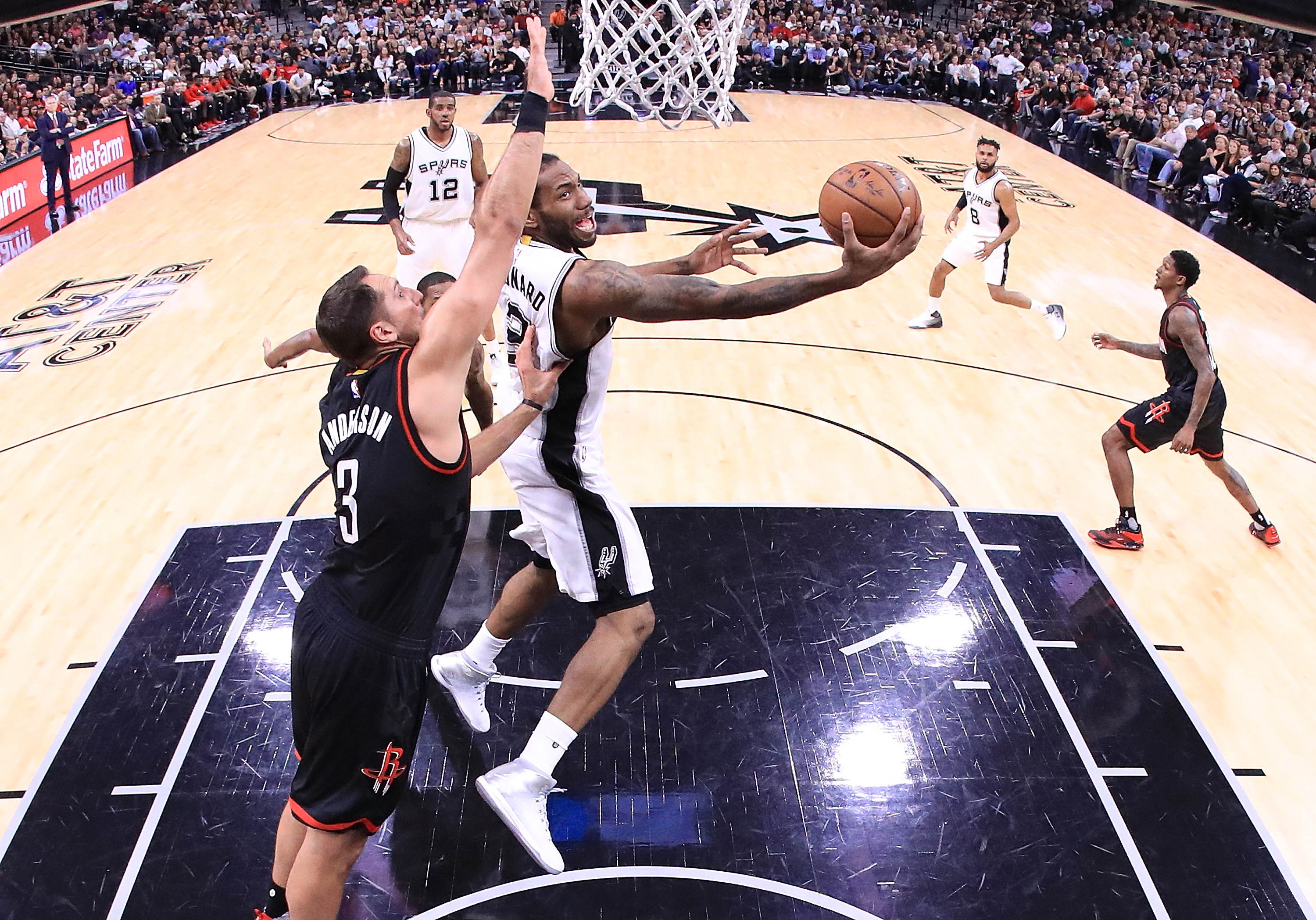 Kawhi Leonard of the  Spurs takes a shot against Ryan Anderson of the Rockets during Game Five of their series Tuesday. (Getty Images)