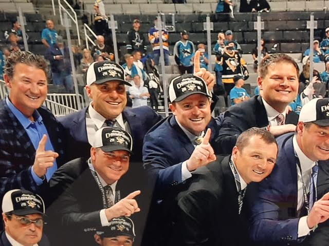 This photo of new Sabres GM Jason Botterill (upper right) celebrating with Penguins coaches and owner Mario Lemieux (top left) after last year's Cup clincher in San Jose is inside the media entrance at PPG Paints Arena. Potential Sabres coach candidate Rick Tocchet is next to Lemieux.