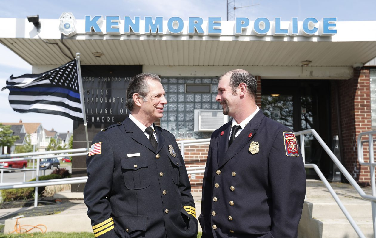 Kenmore Police Chief Peter J. Breitnauer, left, and his son, Kenmore Fire Chief Peter D. Breitnauer, right, at police headquarters in Kenmore on Wednesday, May 17, 2017.         (Mark Mulville/Buffalo News)