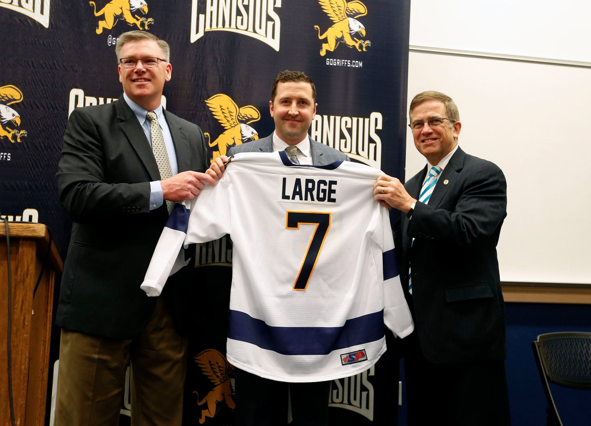 Canisus Athletic Director Bill Maher (left) and President John J. Hurley (right) welcome Trevor Large as the school's seventh hockey coach. (Mark Mulville/Buffalo News)