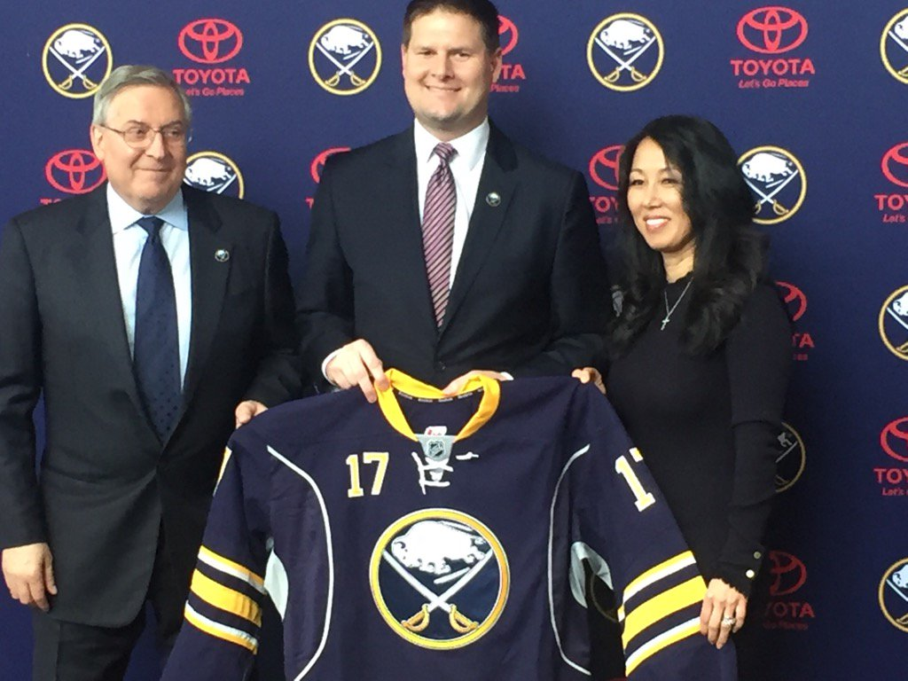 The Pegulas present new GM Jason Botterill with his new jersey. (Mike Harrington/Buffalo News)