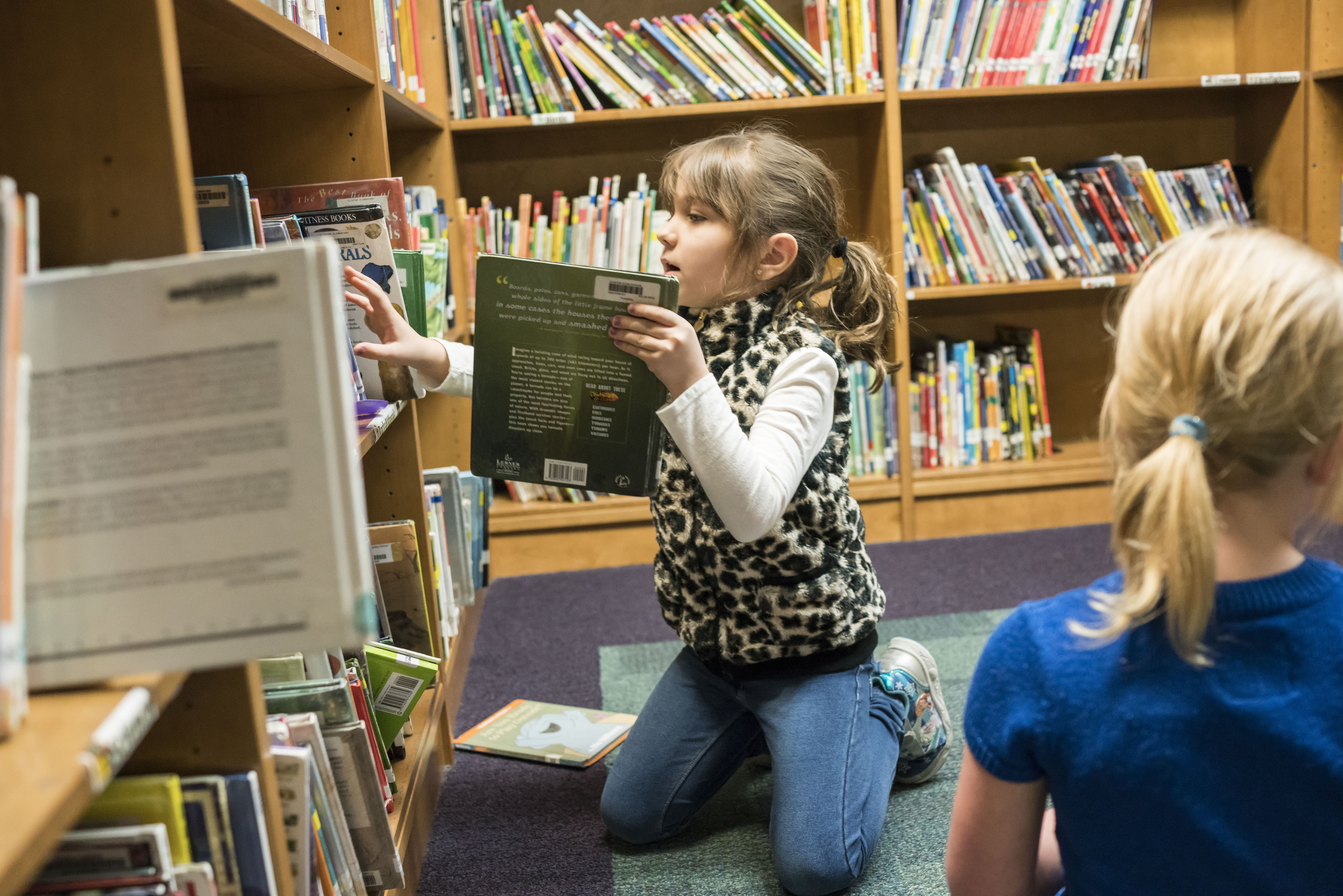 First-grader Jessica Rompala picks out books in the library at Clinton Street Elementary School in West Seneca, Wednesday, May 10, 2017.  (Derek Gee/Buffalo News)