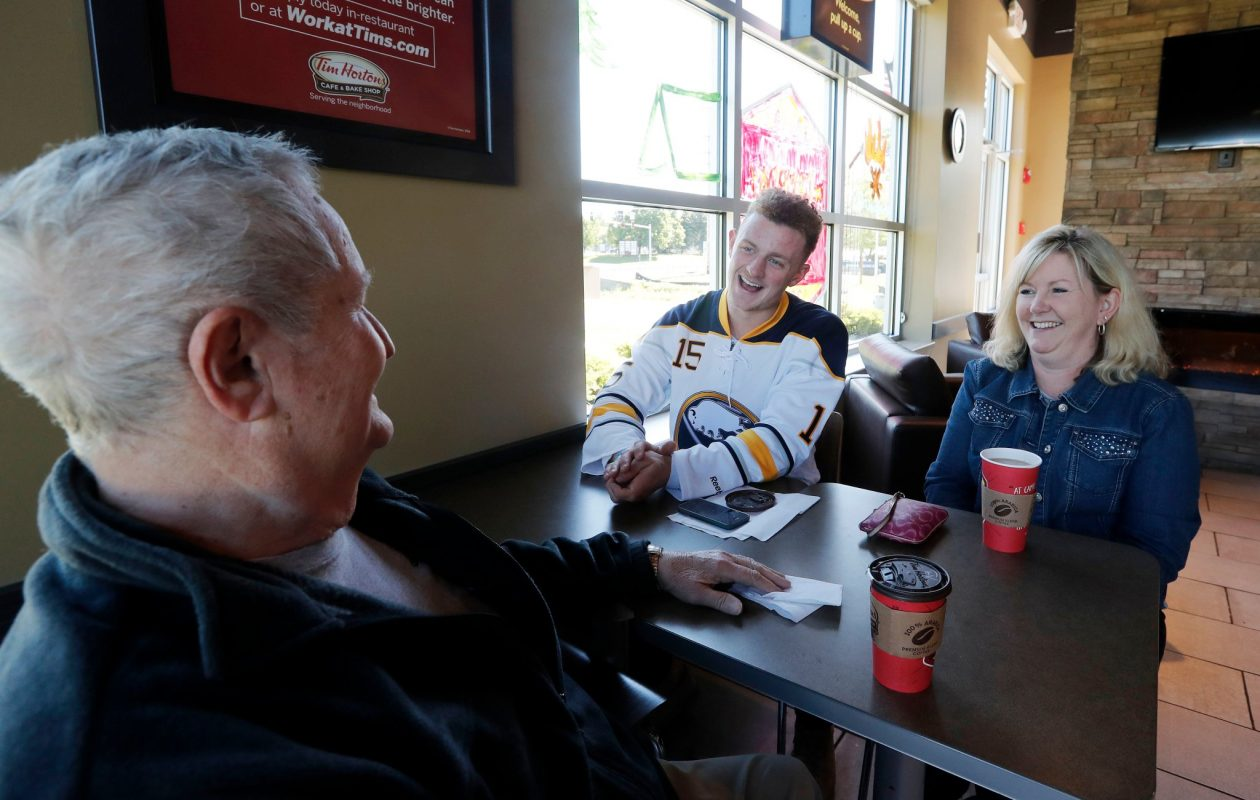Jack Eichel sits with Jim Coughlin and his daughter, Ellen Zimmerman, in Tim Hortons in Orchard Park on Wednesday. (Mark Mulville/Buffalo News)
