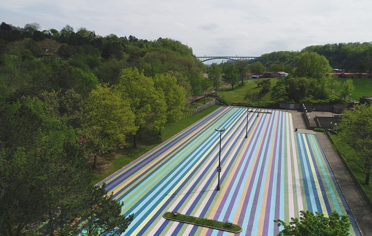 Artpark staff and volunteers have re-created Gene Davis parking lot painting, 'Niagara '79. (Photo   by Andre Nacov.)