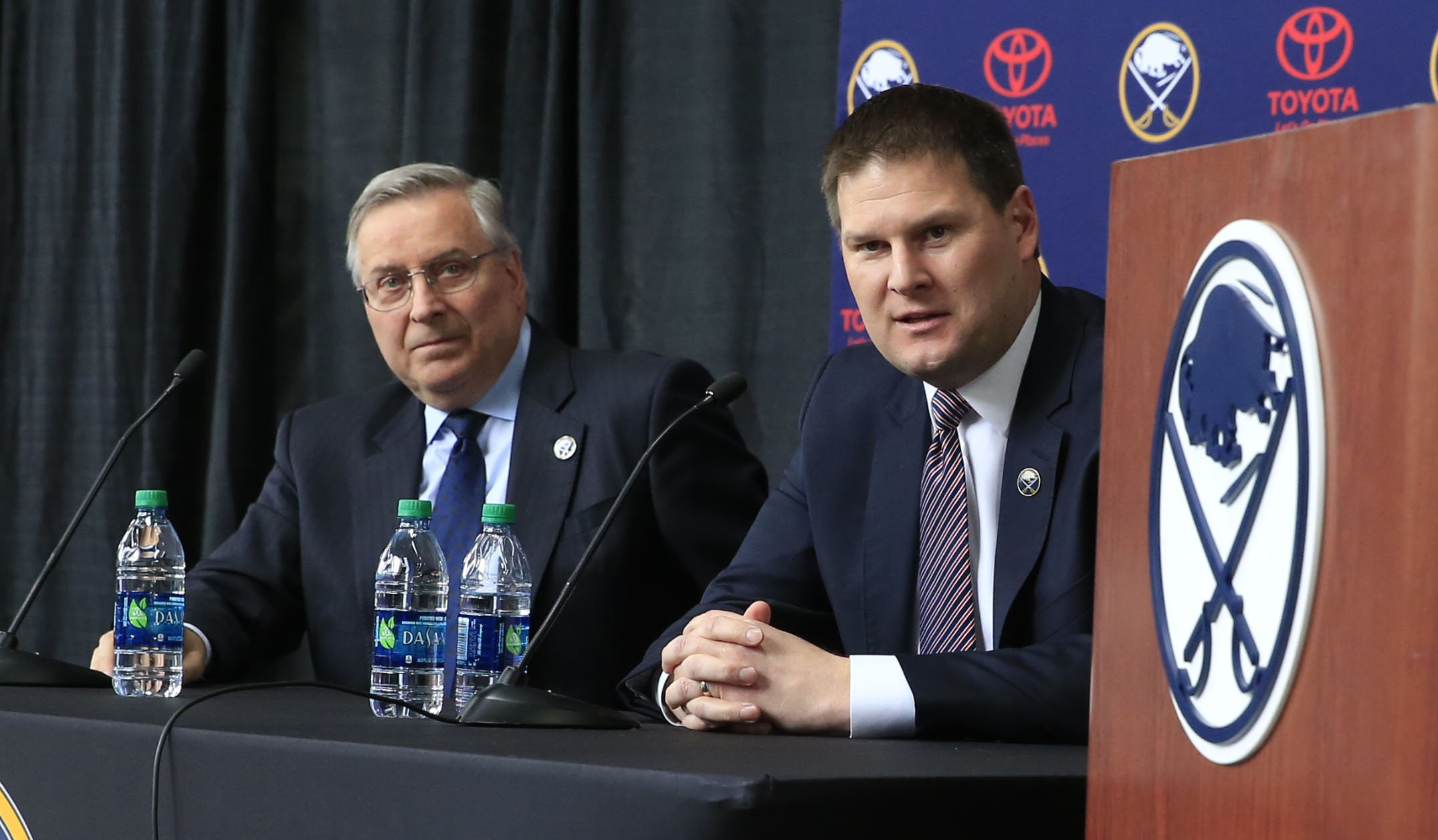 Sabres GM Jason Botterill, right, will interview coaching candidates and bring the finalists to owner Terry Pegula. (Harry Scull Jr./Buffalo News)