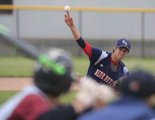 East Aurora's Alex Baase pitches the Blue Devils to a win over top-seeded City Honors at the Johnnie B. Wiley Amateur Athletic Sports Pavilion. (Harry Scull Jr. / Buffalo News)
