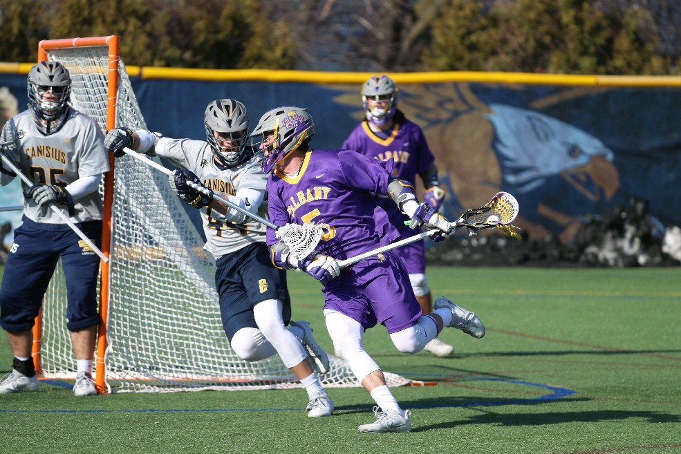 Connor Fields of Albany (5) is up for the highest honor in college lacrosse. (James P. McCoy / Buffalo News).