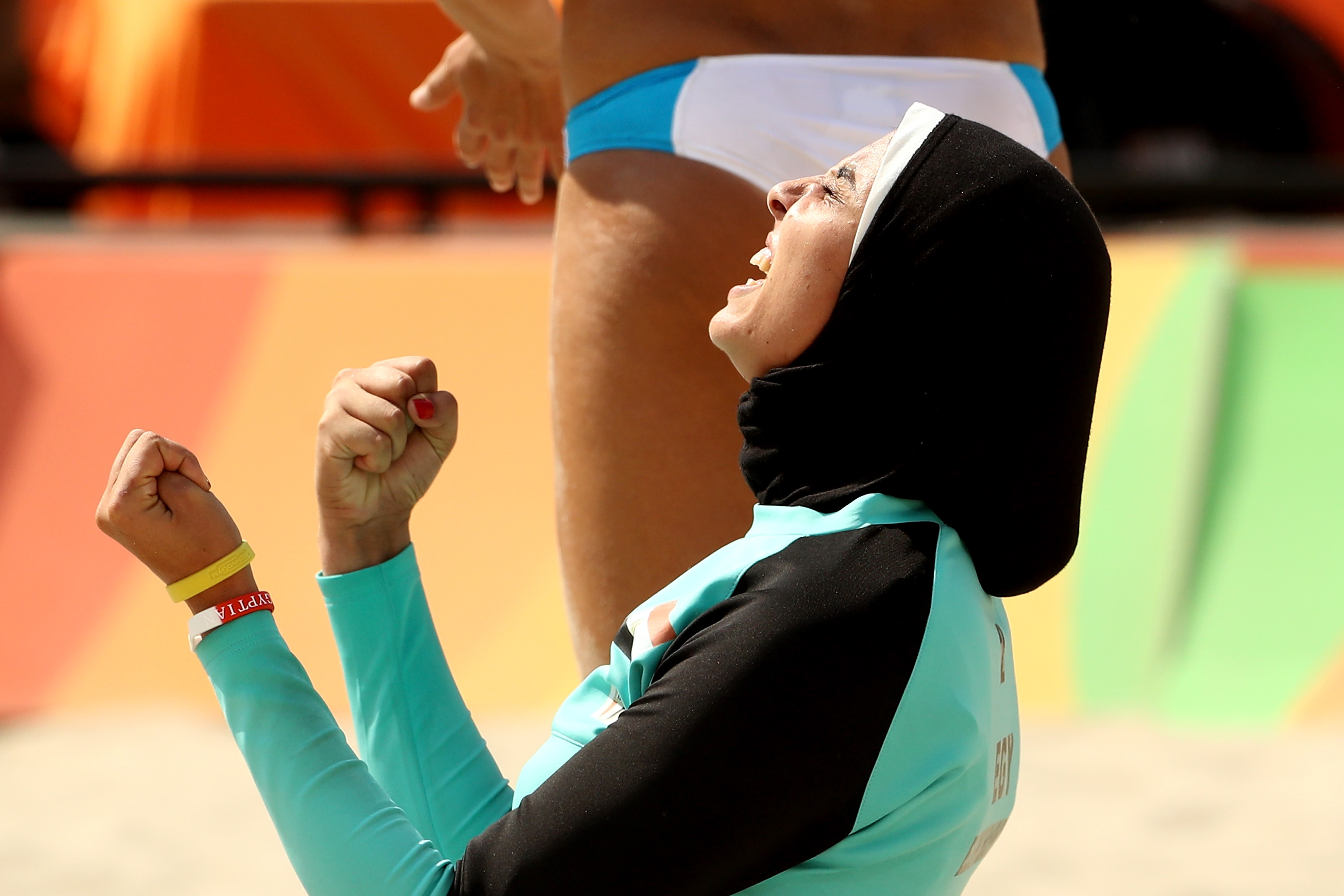 Doaa Elghobashy of Egypt, competing in a hijab, celebrates during a match against Italy in women's beach volleyball at the Rio 2016 Olympic Games. Athletes will now be permitted to wear a hijab in international basketball competition. (Getty Images)