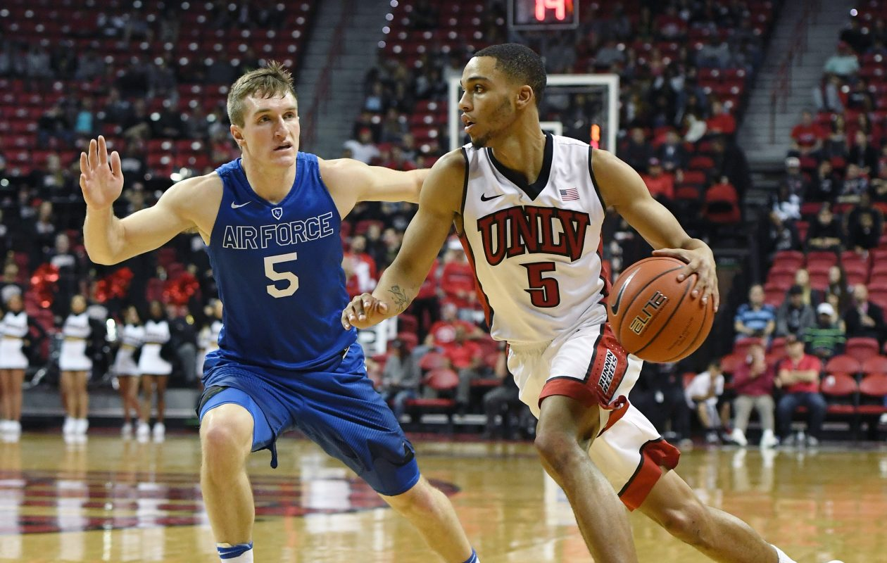 Jalen Poyser, shown in this 2017 file photo, drives for UNLV against Air Force's Zach Kocur. (Ethan Miller/Getty Images)