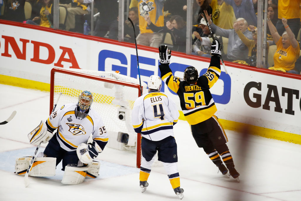 Jake Guentzel celebrates the winning goal that he put past Nashville goalie Pekka Rinne (Getty Images).