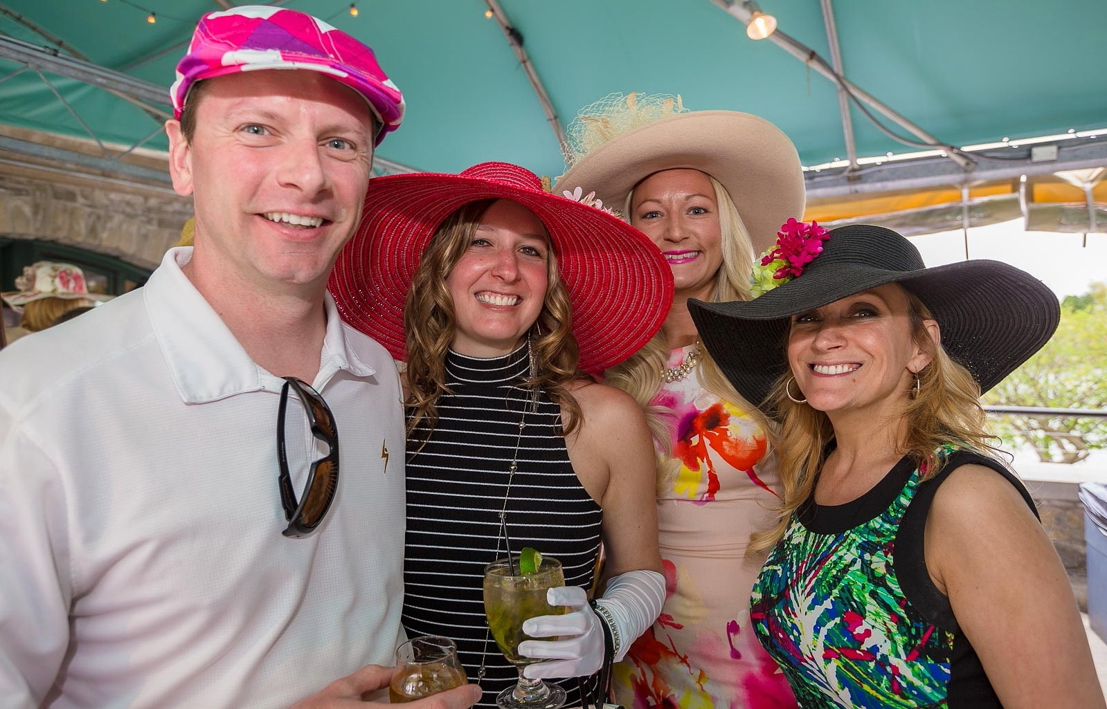 Smiling faces at a Kentucky Derby party in 2016. (Don Nieman/Special to The News)