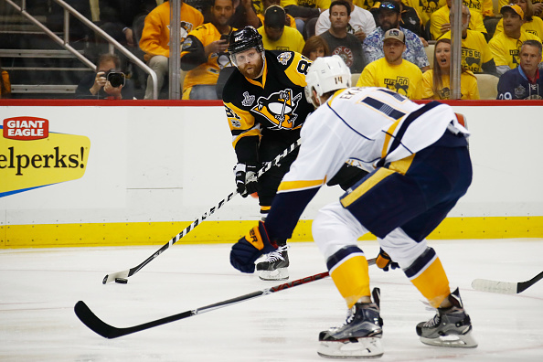 Phil Kessel works against Mattis Ekholm during the first period of Game Two (Getty Images).