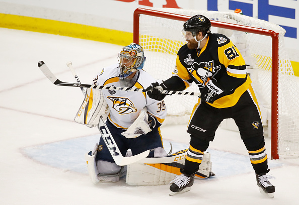Pittsburgh's Phil Kessel battles with Nashville goalie Pekka Rinne in Game One (Getty Images).
