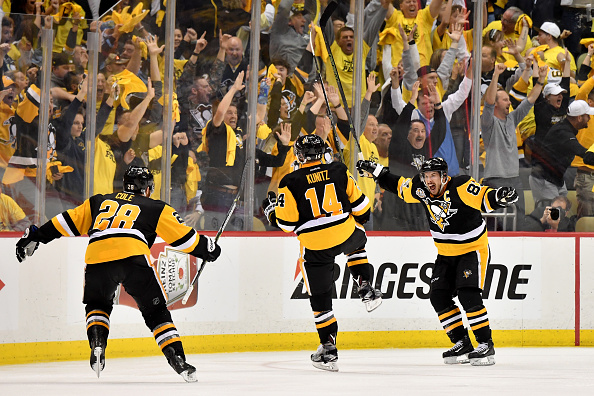 Ian Cole, Chris Kunitz, Sidney Crosby and PPG Paints Arena fans celebrate Kunitz's goal in the second overtime Thursday night that beat Ottawa in Game Seven of the East final (Getty Images).