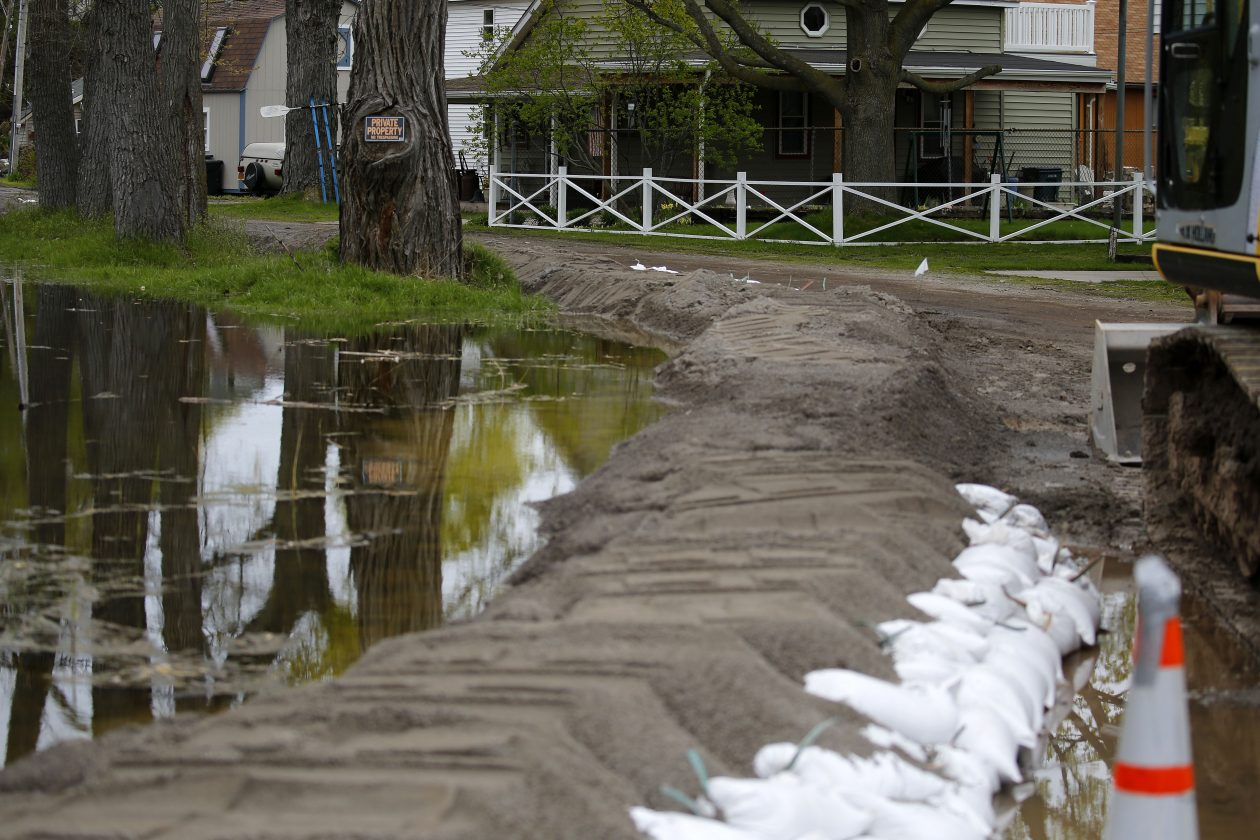 Crews used sand to keep homes from being flooded at the corner of Jackson and Lake streets in Olcott in May 2017. (Mark Mulville/News file photo)