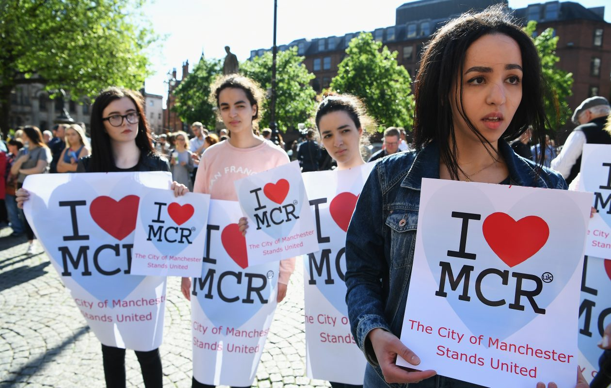 Members of the public hold a vigil in Manchester, known as MCR, to honor the victims of the terror bombing.  (Photo by Jeff J. Mitchell/Getty Images)