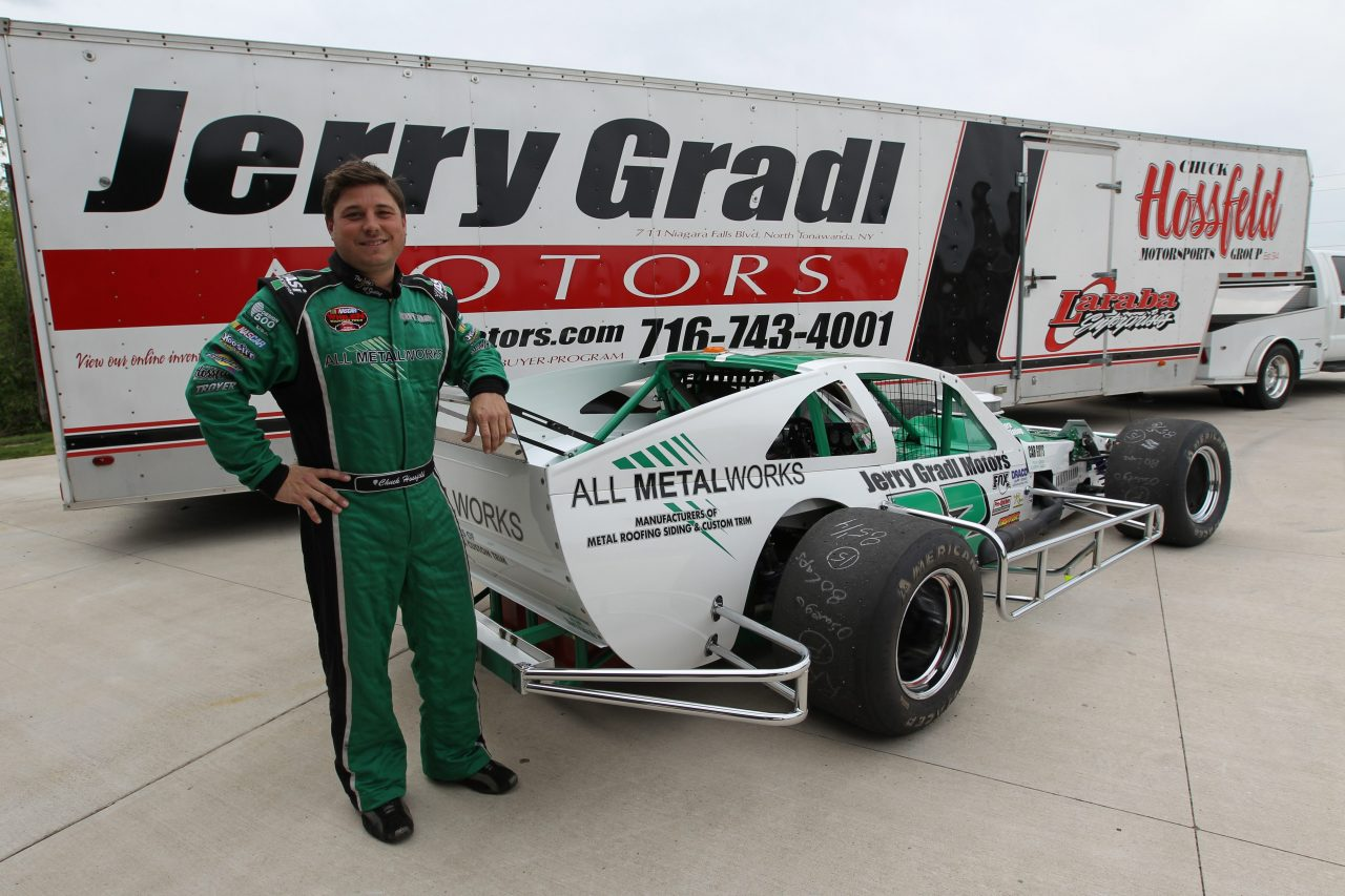 Chuck Hossfeld with his race car at his Lockport home in 2014. (James P. McCoy/News file photo)