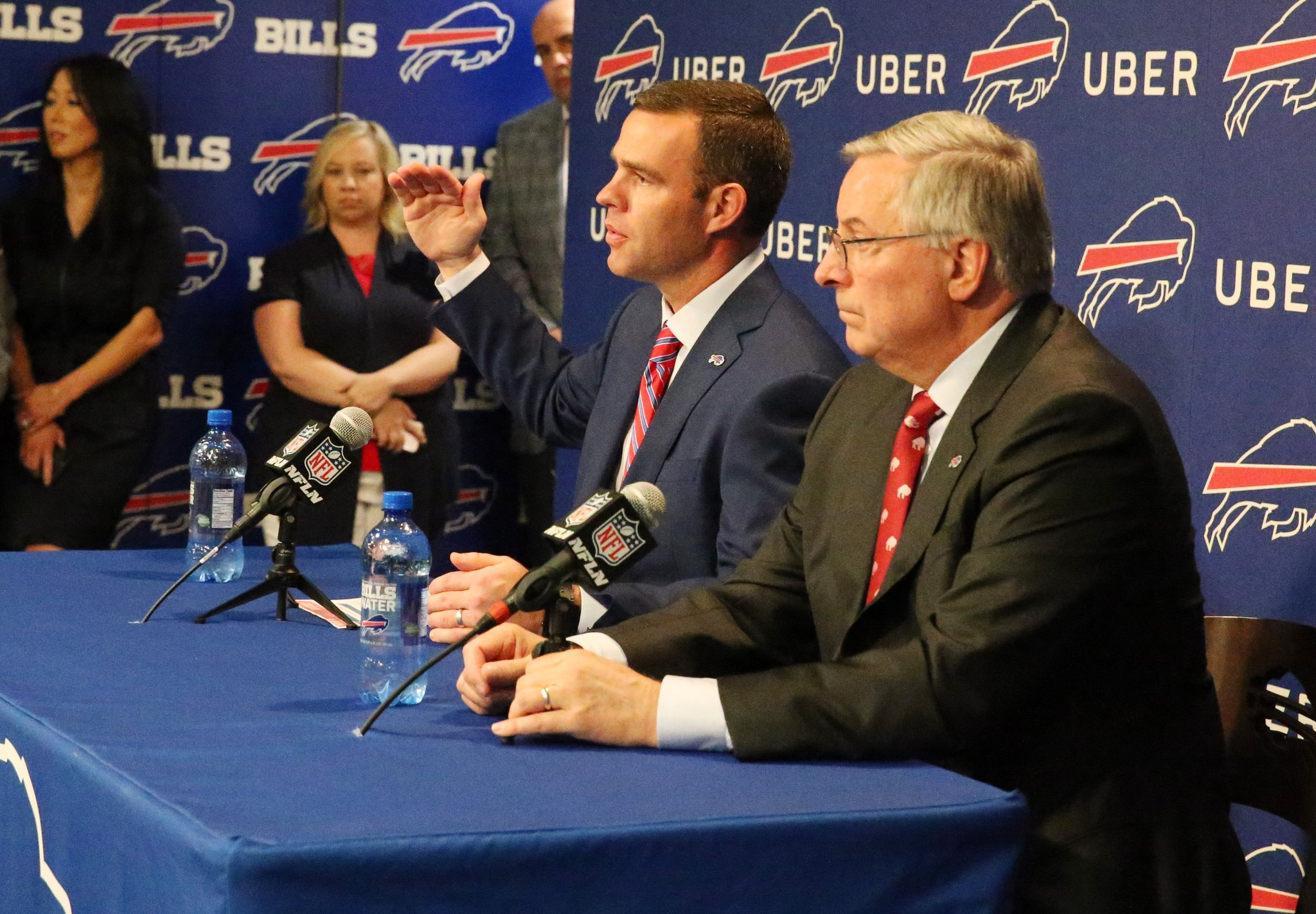 New Bills General Manager Brandon Beane, seated next to owner Terry Pegula, speaks Friday at his introductory news conference. (Photo by James P. McCoy)