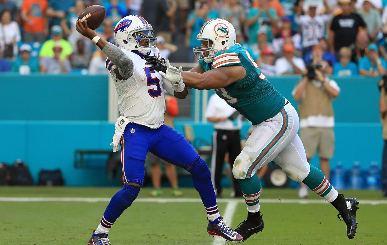 Bills quarterback Tyrod Taylor will have to try and escape the pressure that Dolphins defensive lineman Ndamukong Suh can bring.(Getty Images)
