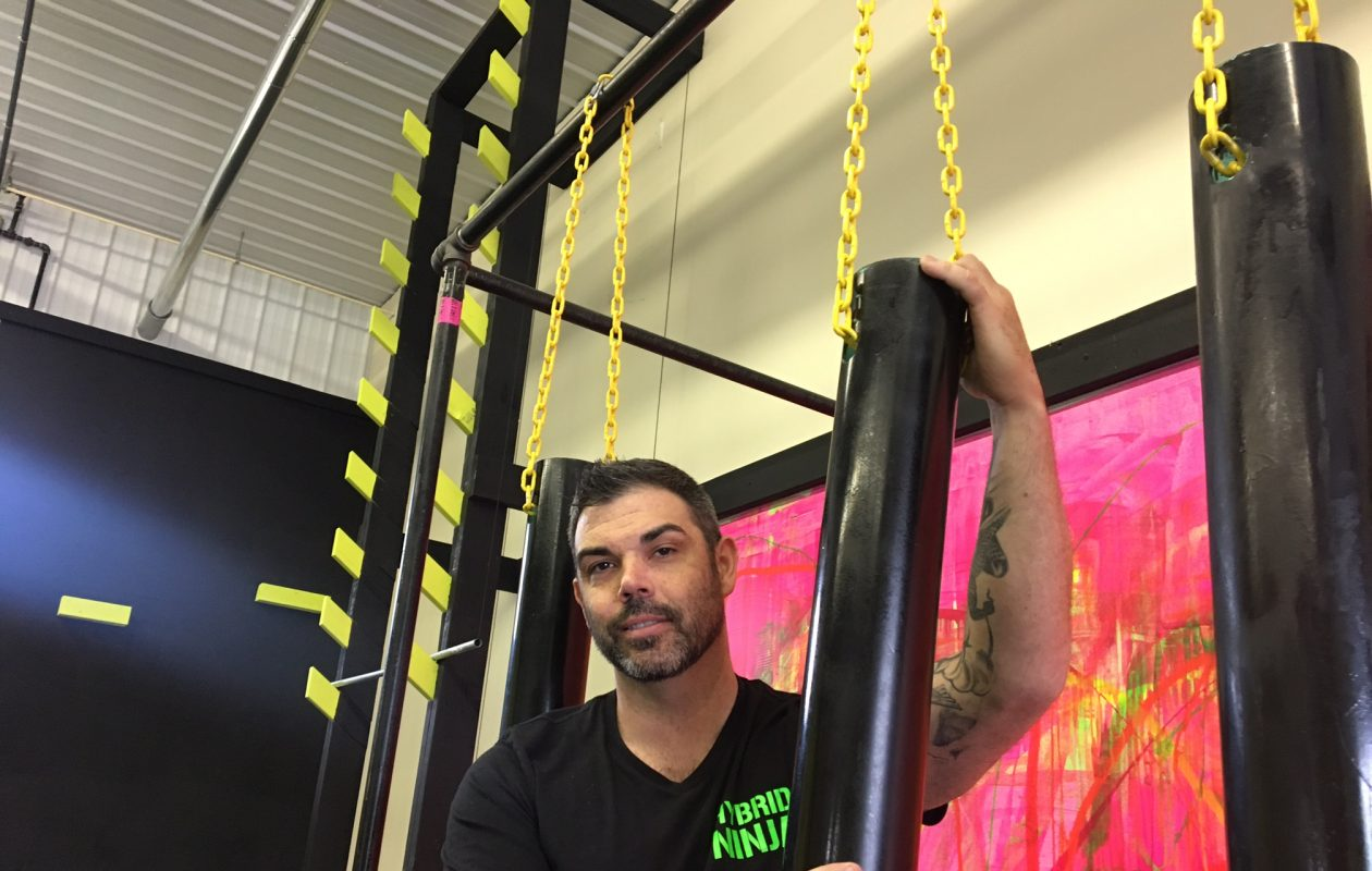 Patrick Hall, owner of Hybrid Ninja Academy fitness centers in Western New York and a former contestant on the NBC-TV hit 'American Ninja Warriors,' is bringing some of the top Ninja Warriors to RiverWorks this week. (Scott Scanlon/Buffalo News)