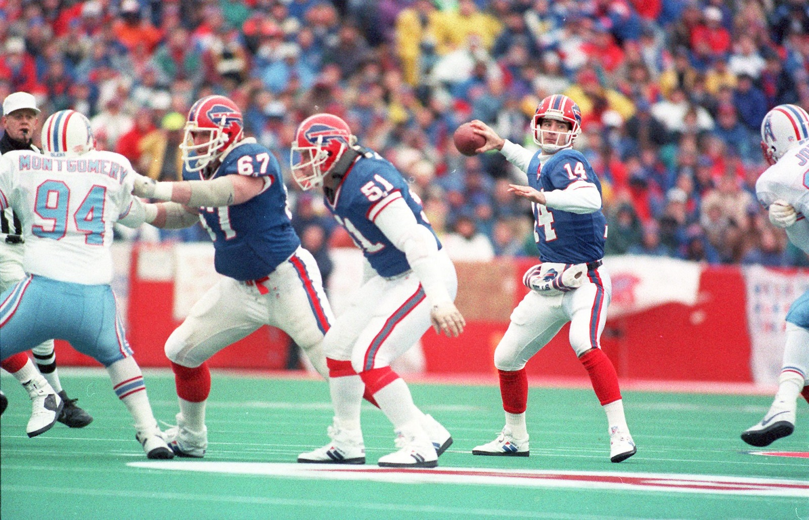 Buffalo Bills quarterback Frank Reich throws a pass during the Bills 41-38 comeback victory over the Houston Oilers on Jan. 3, 1993, in Orchard Park. (News file photo)