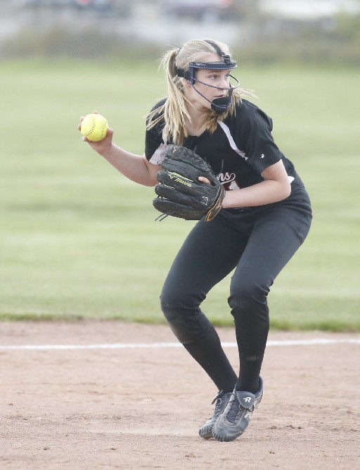 Jenna Ross checks the runner before throwing to first in Niagara Wheatfield's softball win on Friday. (Robert Kirkham / Buffalo News)