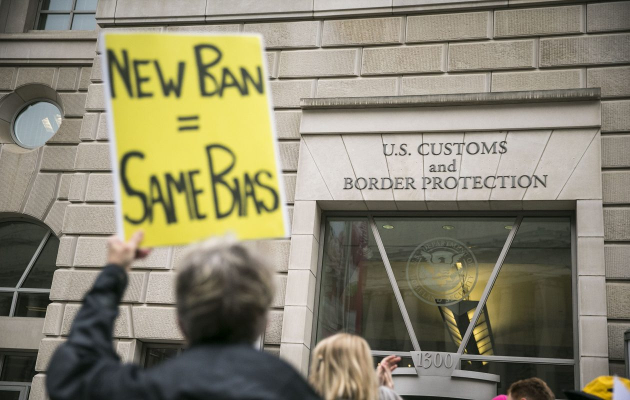 Protesters demonstrate against President Trump's revised travel ban, outside the U.S. Customs and Border Protection headquarters in Washington, March 7, 2017. A federal appeals court in Richmond, Va., refused to reinstate the ban on May 25, saying it discriminated on the basis of religion; the case is likely to go to the Supreme Court. (Al Drago/The New York Times)