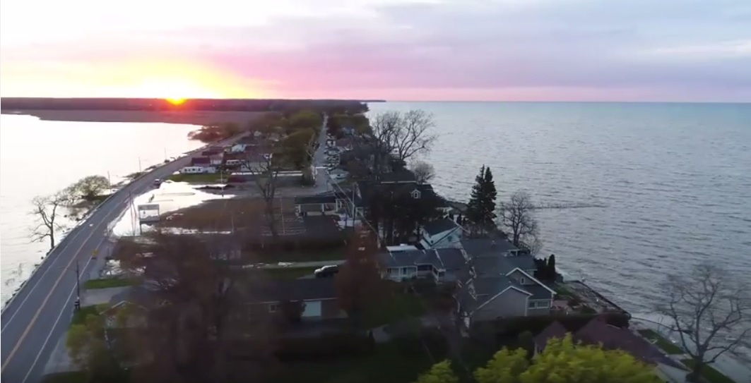 A screenshot of SceniCopter's aerial footage of the flooding along Crescent Beach and Long Pond neighborhood homes in Greece, N.Y.