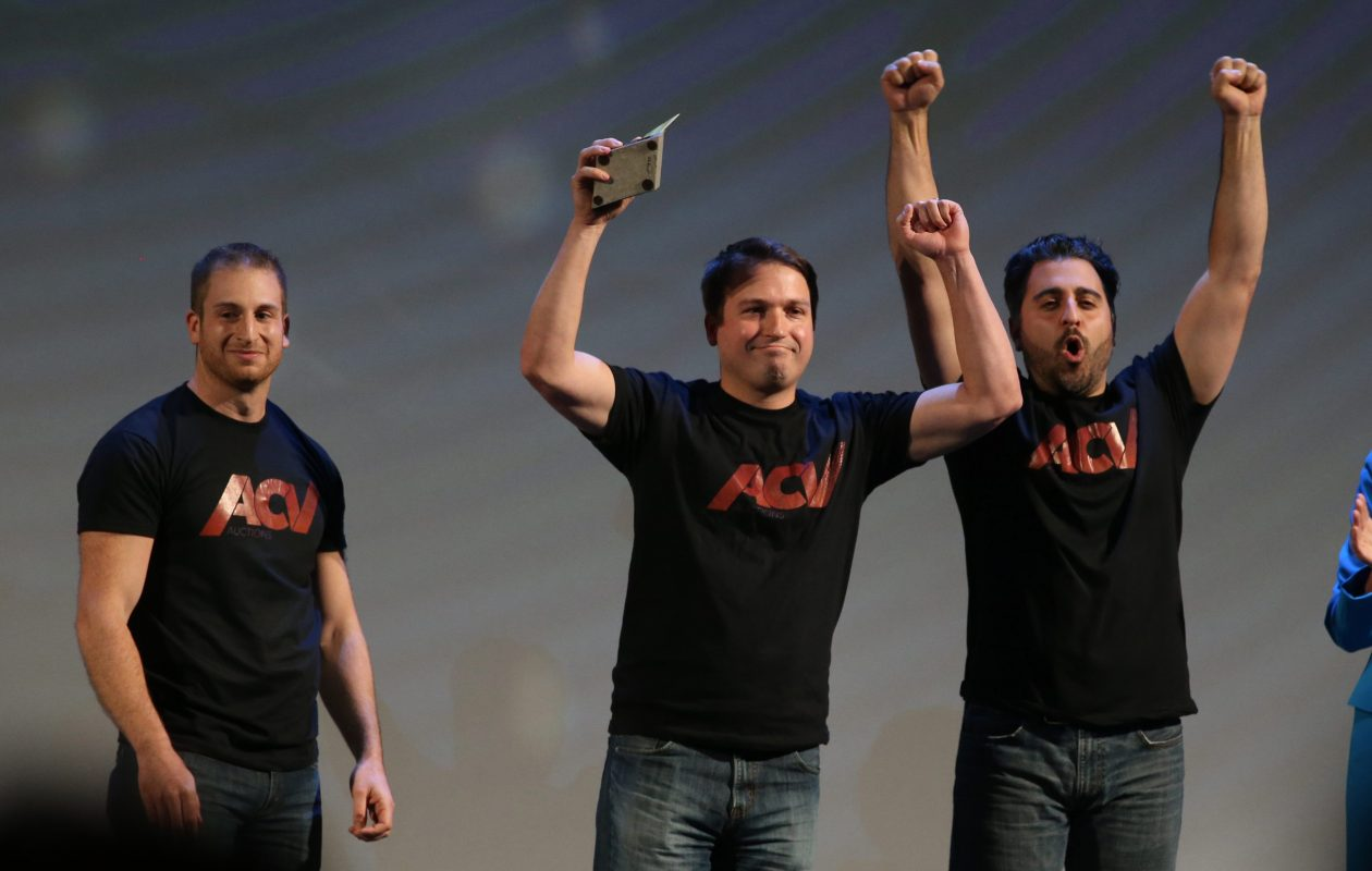 ACV Auctions celebrate their million-dollar win at the 43 North business plan competition, Oct. 29, 2015.  From left are Joe Nieman, Dan Magnuszewski and Jack Greco.  (Sharon Cantillon/Buffalo News)
