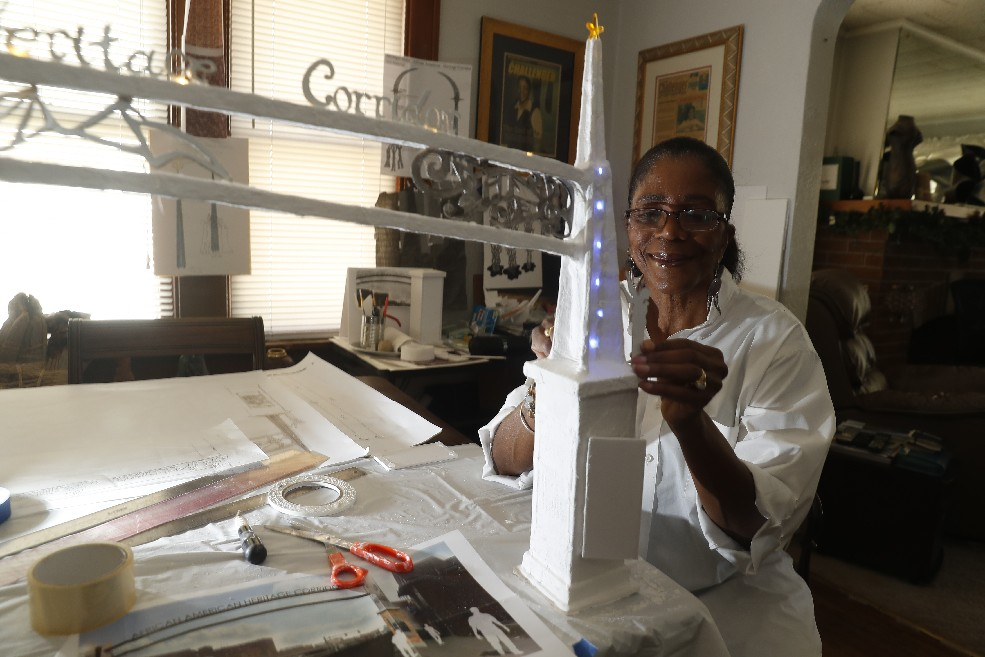Artist Valeria Cray has been working on a model of the $200,000 archway she is designing for the Michigan Street African American Heritage Corridor. (John Hickey/Buffalo News)