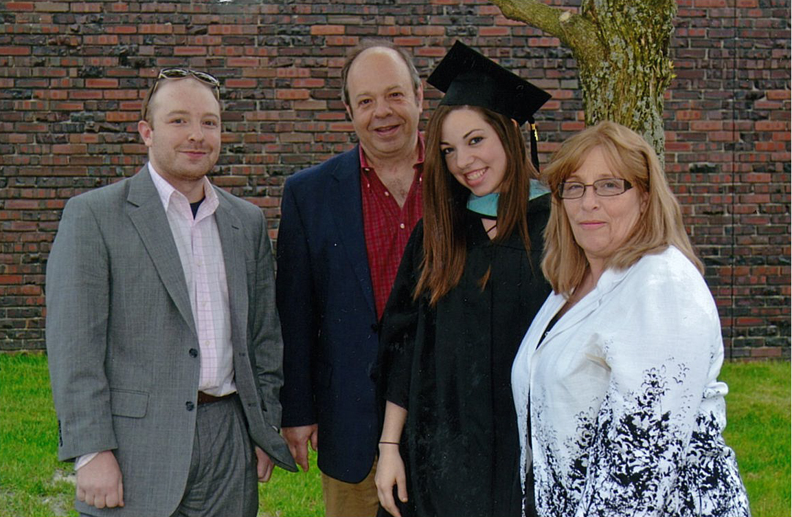 Michael, Joe, Mariya and Susan Camizzi pictured after Mariya received her master's degree in education at SUNY Buffalo State. Mariya, a special education major, died by suicide in 2015. The family are among the organizers of a Walk for Hope in South Buffalo on Saturday.