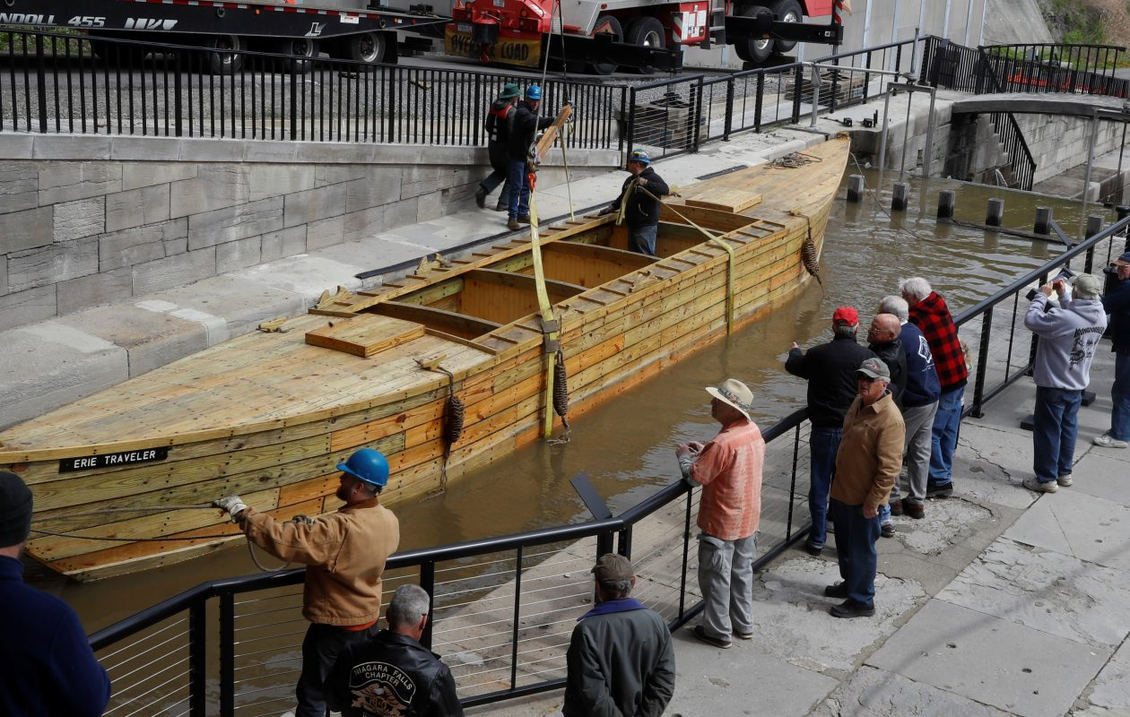 Spectators get a close-up view of the Erie Traveler, a replica of a 19th century Erie Canal cargo boat, after it was hoisted into the original canal locks in Lockport May 11, 2017.  (John Hickey/Buffalo News)