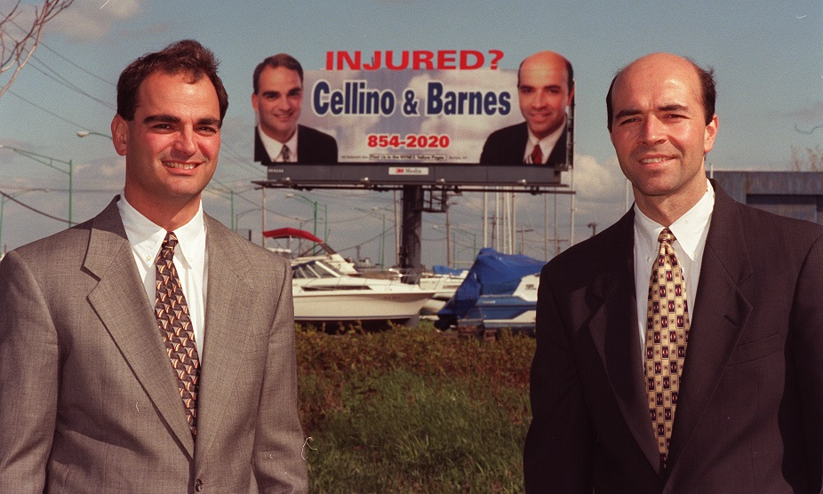 This Buffalo News file photo from 1997 shows Ross Cellino and Stephen Barnes in front of one of their billboards off Fuhrmann Boulevard. (Sharon Cantillon/News file photo)
