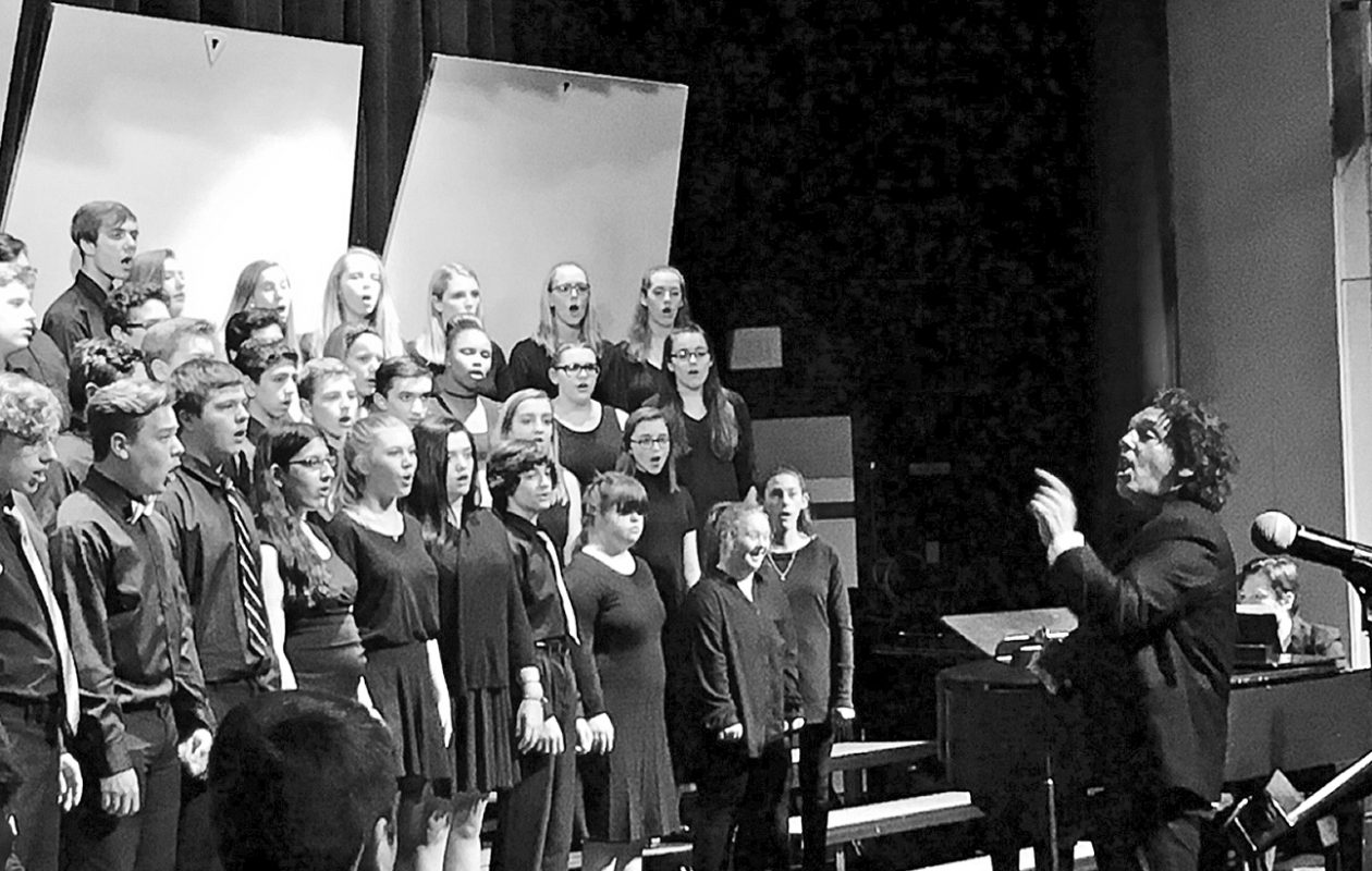 Jim Papoulis conducts Clarence High School's Mixed Chorus in a concert on May 25th.