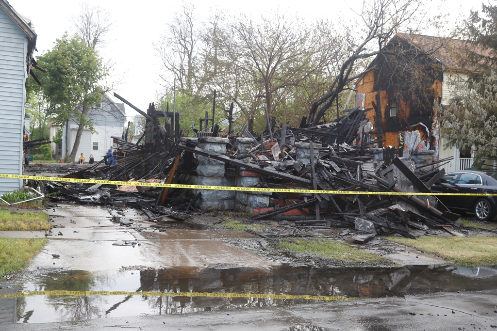 One of two homes destroyed  by fire and other home  damaged from heat on  Northhampton Street Wednesday. (John Hickey/Buffalo News)