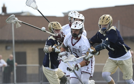 St. Joe's clinched the Monsignor Martin Athletic Association regular season lacrosse title against Canisius Tuesday. (Harry Scull Jr./Buffalo News)
