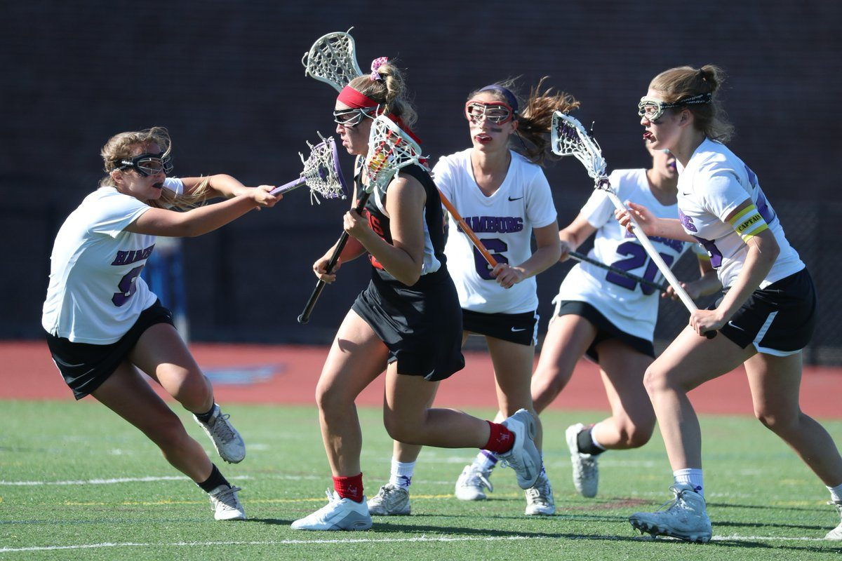 Taylor Ritts of Hamburg tries to defend Erin Wegzyrn of Niagara Wheatfield in the Class B girls lacrosse final. (Photo by James P. McCoy / Buffalo News)