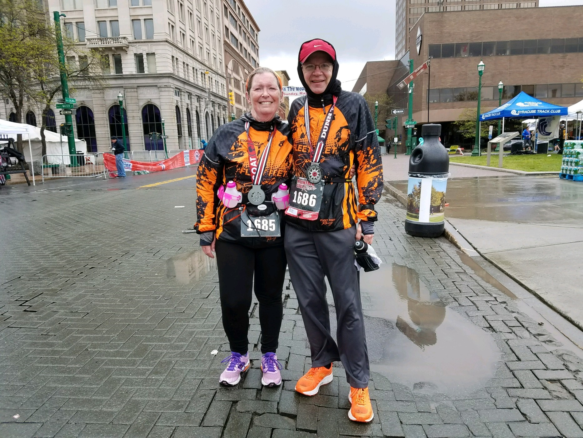 Donna and William Sparkes, who were inspired by the memory of Brendan Jackson to finish Sunday's Mountain Goat Run, in Syracuse. They were in the final handful of finishers on a raw, wet day. (Sean Kirst/submitted image)