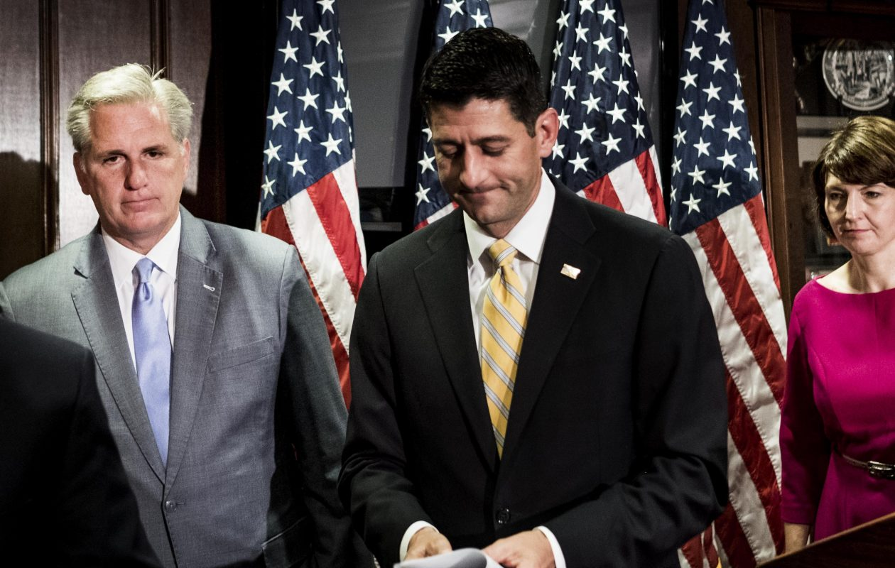 Speaker of the House Paul Ryan, center, and House Majority Leader Kevin McCarthy, left, talk to the press on Wednesday. The two attended a private Republican gathering in June 2016. At the meeting, McCarthy suggested then-candidate Donald Trump was being paid by Russian President Vladimir Putin. (Washington Post by Melina Mara)