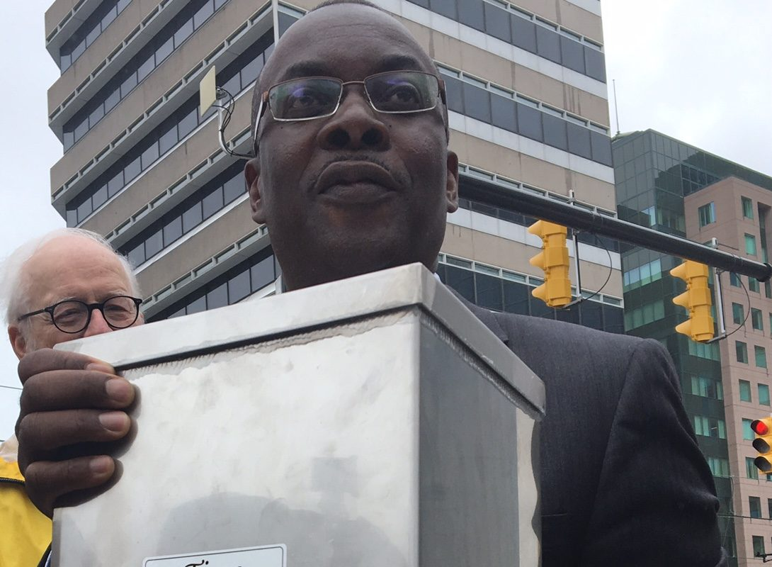 Mayor Brown shows off new time capsule to be inserted in The Hiker statue in Roosevelt Square