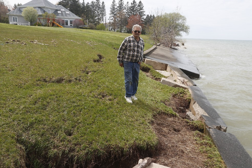 Wilson homeowner Willard Antoncich shows where his seawall and yard are disappearing into a rising Lake Ontario as residents continue to look for help to cope with massive flooding. (John Hickey/Buffalo News)